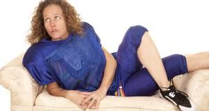 Woman Football Player Lay On Sofa