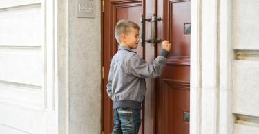 Little boy knocking the door