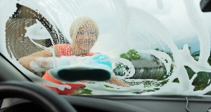 woman washes her car