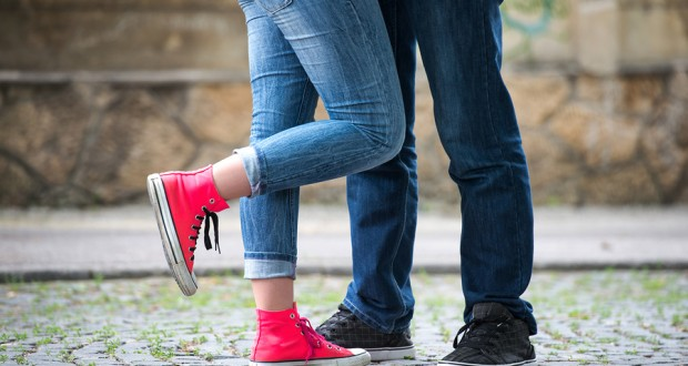 Legs of a couple of teenagers in love