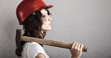 Woman working in helmet