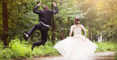 Wedding couple - bride and groom - running down the road ** Note: Soft Focus at 100%, best at smaller sizes