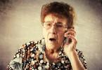 Surprised seniors talking mobile phone. Old adult mature woman. Shock