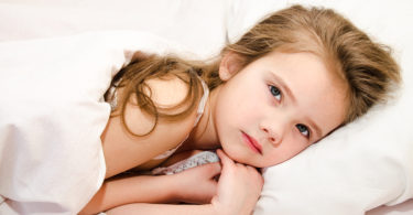 Little Girl Lying In The Bed