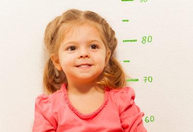 Little girl measuring height