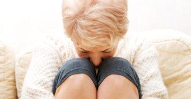 woman sad yoga pants
