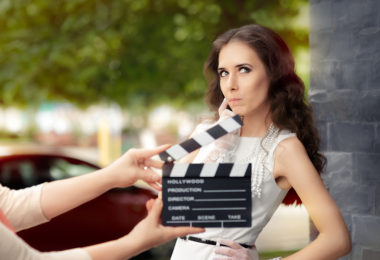 Young professional cinema star acting in a film