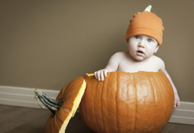 Baby boy in pumpkin,