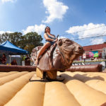 Woman riding mechanical bull