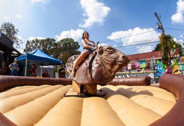 Woman riding mechanical bull