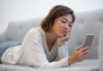 Woman on phone, scrolling