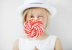 young girl with big spiral lollipop