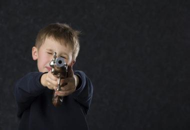 six year old with gun